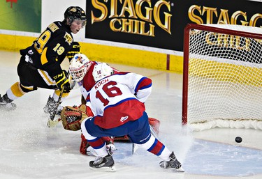 Edmonton's Tristan Jarry is scored on by Brandon's Nolan Patrick during the third period of the Edmonton Oil Kings' WHL hockey game against the Brandon Wheat Kings at Rexall Place in Edmonton, Alta., on Tuesday, March 31, 2015. The Wheat Kings won 3-2. Codie McLachlan/Edmonton Sun/QMI Agency