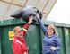JOANNE McQUARRIE/Record-Gazette Butch Mitchell, supervisor, public works department, and Sandi Adams, acting director of engineering and infrastructure, tossed a bag of garbage in a bin at the town yard along River Road in Peace River. They're getting equipment and bins ready for the annual spring clean-up, scheduled from May 8 - 18 this year.