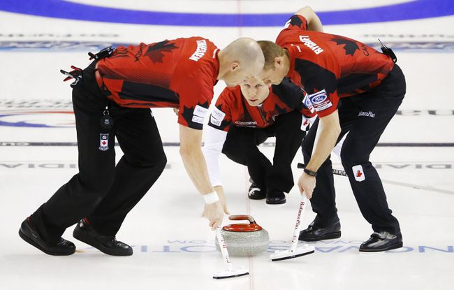 Canadian skip Pat Simmons delivers a rock against Switzerland during the 12th draw of the world championship in Halifax April 1, 2015. (REUTERS/Mark Blinch)