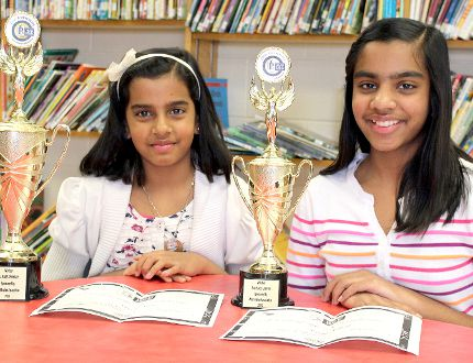 Wania Noor, 9, left, and her 11-year-old sister Areeba Ashraf, of Ridgetown, participated in a regional spelling bee in Windsor on Saturday and came home with first and second place, respectively in their divisions. Noor will advance to a provincial competition in Toronto in May. Photo taken in Ridgetown, On., on Wednesday, April 1, 2015. (Vicki Gough/Chatham Daily News/QMI Agency)