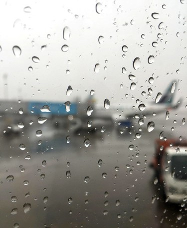 Water droplets sit on a window of a WestJet 737 as another one is seen in the background at the Edmonton International Airport on Tuesday April 1, 2015. Birgit Braid/Edmonton Sun/ QMI Agency