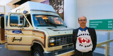 """Doug Alward, best friend of Terry Fox, poses for a photo beside the van that he drove to accompany Terry, is part of an exhibit at the Canadian Museum of History honouring the 35th anniversary of Terry Fox's heroic Marathon of Hope. The exhibition is entitled """"Terry Fox-Running to the Heart of Canada"""", will be on display from April 2, 2015 to January 24, 2016 at the museum. April 1, 2015. Errol McGihon/Ottawa Sun/QMI Agency"""