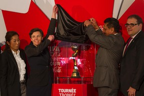 The Hon. Bal Gosal, Minister for Sport, unveils the Womans FIFA World Cup trophy at the Ottawa City Hall on April 1, 2015. Ottawa is the first of six cities to present the trophy throughout Canada. (Joel Watson/Ottawa Sun/QMI Agency)