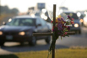 A memorial is seen at the intersection of St. Mary's Road and Bishop Grandin Boulevard in Winnipeg Monday, November 1, 2010 near where Amutha Subramanian and Senhit Mehari were killed by a 17-year-old female driver allegedly under the influence of alcohol.