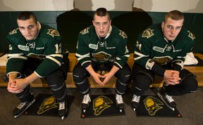 London Knights Jack Hindi, Owen McDonald and Chandler Yakimowicz pose for a photo in the lockerrom at Budweiser Gardens in London Knights in London. These three players have been a powerful asset to the team. (ANDREW LAHODYNSKYJ, Special to The Free Press)