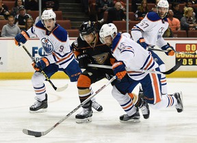 Jordan Eberle tangles with Ducks forward Andrew Cogliano during first period action Wednesday in Anaheim. (USA TODAY SPORTS)