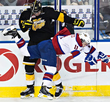 Edmonton's Luke Bertolucci hits Brandon's Eric Roy during the third period of the Edmonton Oil Kings' WHL playoff hockey game against the Brandon Wheat Kings at Rexall Place in Edmonton, Alta., on Wednesday, April 1, 2015. The Wheat Kings won 3-2, ending the playoffs for the Oil Kings. Codie McLachlan/Edmonton Sun/QMI Agency
