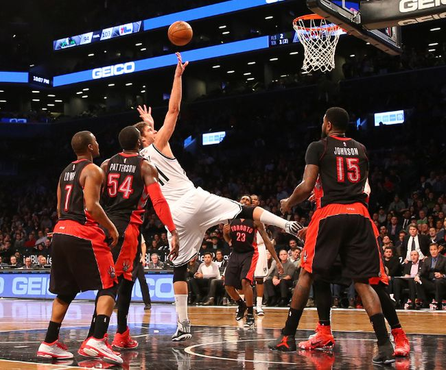 Nets centre Brook Lopez tosses a shot up in overtime against the Raptors earlier this season. The Raptors need to keep winning if they want to lock up the third seed in the East. (USA TODAY)