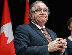 Canada's Aboriginal Affairs Minister Bernard Valcourt take part in a news conference following the National Roundtable on Missing and Murdered Indigenous Women and Girls in Ottawa February 27, 2015. REUTERS/Chris Wattie