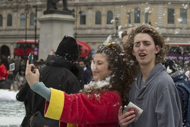 Participants take part in International Pillow Fight Day at Trafalgar Square in London, April 4, 2015. (Euan Cherry/WENN.COM)
