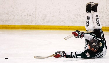 Brady Cook, Matt Cook's older brother, plays in a friendly sledge hockey game during the fourth annual 24 Hour Charity Challenge at the Canadian Athletic Club in Edmonton, Alta., on Saturday, March 28, 2015. The challenge raises funds for the Matt Cook Foundation. Ian Kucerak/Edmonton Sun/ QMI Agency