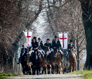 Easter riders of the Sorb community ride on horses during a traditional Easter procession in Zerwitz, eastern Germany, on April 5, 2015. Easter is a particularly important time of the year for Sorbs, a Slavic minority in eastern Germany. Many Sorbs still speak Sorbian, a language closely related to Polish and Czech. AFP PHOTO / DPA / PATRICK PLEUL