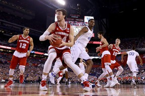 Wisconsin Badgers' Frank Kaminsky handles the ball against the Kentucky Wildcats on Saturday night. In their one meeting this season, Duke beat Wisconsin. (afp)