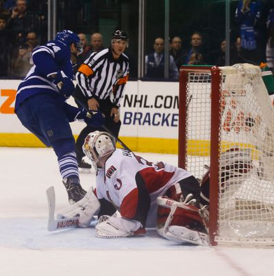 Toronto Maple Leafs� Peter Holland (24) beats Ottawa Senators Andrew Hammond (30) in the shootout to win the game for the Leafs in Toronto on Monday April 6, 2015. Jack Boland/Toronto Sun/QMI Agency