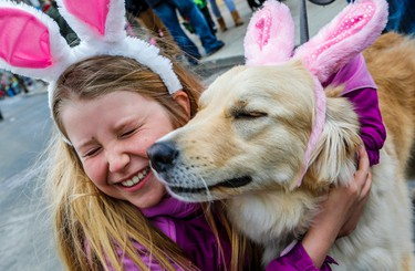 The Lion's Club, annual Easter Parade was just as colourful as usual as the bands marched across Queen St. in the Beach, in Toronto, Ont. 9 year old Hazel gets a lick of love from one year old Bruno on Sunday April 5, 2015. Dave Thomas/Toronto Sun