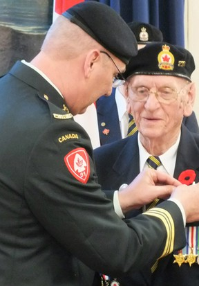 A medal is pinned to Ted Paisley's lapel during a ceremony at the Royal Canadian Legion hall in Petrolia. Paisley was awarded the French Legion of Honour Medal for his efforts in liberating France over 70 years ago. (BRENT BOLES, QMI Agency)