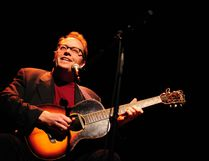 Rick Fines, seen on acoustic guitar, is in the spotlight with a new release. Submitted Photo