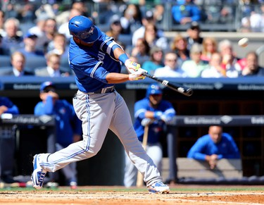NEW YORK, NY - APRIL 06: Edwin Encarnacion #10 of the Toronto Blue Jays hits a two run homer in the third inning against the New York Yankees during Opening Day on April 6, 2015 at Yankee Stadium in the Bronx borough of New York City.   Elsa/Getty Images/AFP