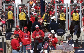 Fans stream through newly installed metal detectors at Nationals Park prior to the Washington Nationals Opening Day game againt the New York Mets at Nationals Park on April 6, 2015 in Washington, DC. (Win McNamee/Getty Images/AFP)