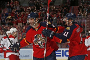Jonathan Huberdeau #11 congratulates Jaromir Jagr #68 of the Florida Panthers as he celebrates after scoring a second period goal against the Carolina Hurricanes at the BB&T Center on April 2, 2015 in Sunrise, Florida. (Joel Auerbach/Getty Images/AFP)