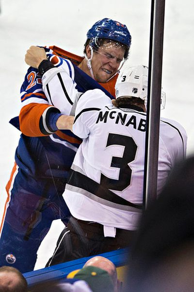 Edmonton's Keith Aulie (22) fights Los Angeles' Brayden McNabb (3) during the first period of the Edmonton Oilers' NHL hockey game against the Los Angeles Kings at Rexall Place in Edmonton, Alta., on Tuesday, April 7, 2015. Codie McLachlan/Edmonton Sun/QMI Agency