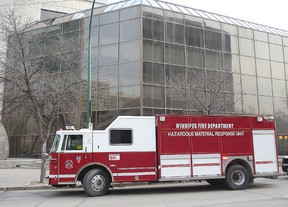 The Winnipeg Fire Department hazardous materials unit sits outside the Law Courts in Winnipeg, Man. Wednesday, April 8, 2015 after the report of a suspicious package.