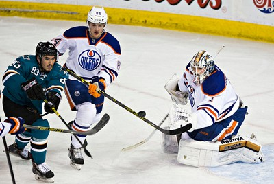 Edmonton's goalie Laurent Brossoit (1) stops San Jose's Matt Nieto (83) during the first period of the Edmonton Oilers' NHL hockey game against the San Jose Sharks at Rexall Place in Edmonton, Alta., on Thursday, April 9, 2015. Codie McLachlan/Edmonton Sun/QMI Agency