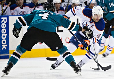 Edmonton's Taylor Hall (4) tries to get past San Jose's Brenden Dillon (4) during the second period of the Edmonton Oilers' NHL hockey game against the San Jose Sharks at Rexall Place in Edmonton, Alta., on Thursday, April 9, 2015. Codie McLachlan/Edmonton Sun/QMI Agency