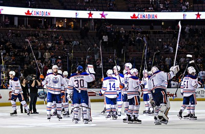 The Oilers salute the crowd during the third period of the Edmonton Oilers' NHL hockey game against the San Jose Sharks at Rexall Place in Edmonton, Alta., on Thursday, April 9, 2015. The Sharks won 3-1. Codie McLachlan/Edmonton Sun/QMI Agency