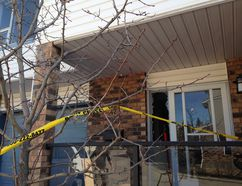 A teenage boy who lives in this condo at Coachway Garden S.W. narrowly avoided succumbing to carbon monoxide poisoning that had already knocked out his mother an sister. The teen passed out while on the phone with a 911 dispatcher early Friday, April 1,0, 2015. (Photo by Jim Well/Calgary Sun)