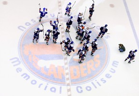 The New York Islanders celebrate their win over the Buffalo Sabres at the Nassau Veterans Memorial Coliseum on April 4, 2015 in Uniondale, N.Y. (Bruce Bennett/Getty Images/AFP)