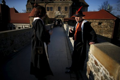 Participants talk in front of the castle before the role play event at Czocha Castle in Sucha, west southern Poland April 9, 2015. Harry Potter enthusiasts from all over the world are attending a four-day live action role play event at the medieval castle made into a close imitation of the 'College of Wizardry'. REUTERS/Kacper Pempel