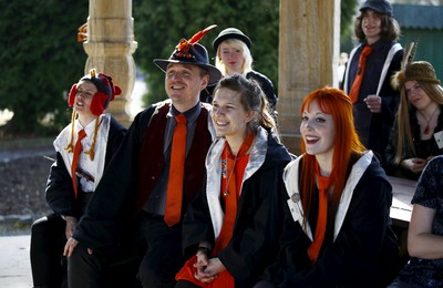 A group of participants listen to instructions during a workshop before the role play event at Czocha Castle in Sucha, west southern Poland April 9, 2015.Harry Potter enthusiasts from all over the world are attending a four-day live action role play event at the medieval castle made into a close imitation of the 'College of Wizardry'. REUTERS/Kacper Pempel