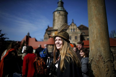 Stine Nielsen from Denmark smiles after arriving for the role play event at Czocha Castle in Sucha, west southern Poland April 9, 2015. Harry Potter enthusiasts from all over the world are attending a four-day live action role play event at the medieval castle made into a close imitation of the 'College of Wizardry'. REUTERS/Kacper Pempel