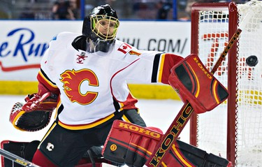 Calgary's goalie Jonas Hiller (1) makes a save during the first period of the Edmonton Oilers' NHL hockey game against the Calgary Flames at Rexall Place in Edmonton, Alta., on Saturday, April 4, 2015. Codie McLachlan/Edmonton Sun/Sun Media