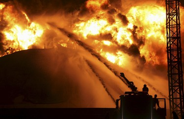 Firefighters try to extinguish a fire at a petrochemical plant in Zhangzhou, Fujian province April 7, 2015. At least six people were injured after an explosion hit part of an oil storage facility on Monday at Dragon Aromatics, Xinhua reported. The fire, which had been put off, resumed at around 7:40 p.m. on Tuesday. It was later extinguished again at around 11:40 p.m., at the plant that produces paraxylene, or PX, a chemical used in making polyester fibre and plastics, state media said. Picture taken April 7, 2015. REUTERS/Stringer