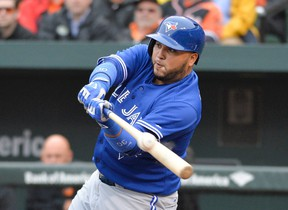 Blue Jays catcher Dioner Navarro hits a two-run double during first inning MLB action against the Orioles in Baltimore on Friday, April 10, 2015. (Tommy Gilligan/USA TODAY Sports)