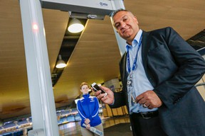 Rogers Centre, VP of stadium operations and security, Mario Coutinho, shows the new metal detectors installed at the Rogers Centre on April 10, 2015. (Dave Thomas/Toronto Sun)