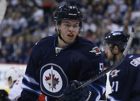 Andrew Copp played his first NHL game — and earned his first point —against Calgary.  (KEVIN KING/Winnipeg Sun)