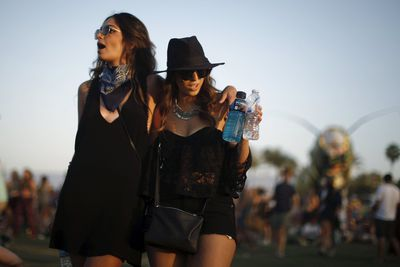 Women dance to Hozier at the Coachella Valley Music and Arts Festival in Indio, California April 11, 2015. REUTERS/Lucy Nicholson