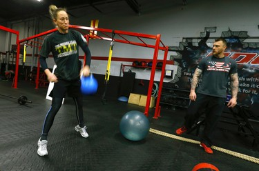 """Canadian UFC fighter Jessica """"Ragin"""" Rakoczy  trains at the EPC centre with her trainer Joe Arko (R) in Burlington, Ont. on Thursday April 9, 2015. She will be on the card at UFC 186 in Montreal at the Bell Centre fighting Valerie Letourneau on Saturday April 25. Jack Boland/Toronto Sun/QMI Agency"""