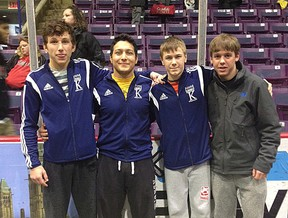 Kingston Wrestling Club members, from left, Ben Zahra, Ameen Aghamiriam, Connor Quinton and T.J. Taylor competed at the Canadian Cadet and Juvenile Wrestling Championships in Fredericton on the weekend. (Supplied photo)