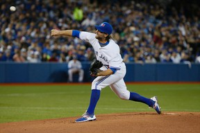 R.A. Dickey's throws his first pitches in the 1st inning at  the Toronto Blue Jays home opener against the Tampa Bay Rays at the Rogers Centre in Toronto, Ont. on Monday April 13, 2015. Stan Behal/Toronto Sun/Postmedia Network
