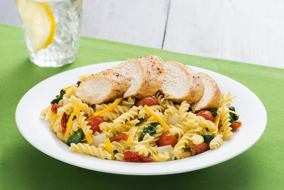 <B>Easy Homemade Fusilli with Oven Baked Chicken</B><BR>Chef Brian Vallipuram, Lord Elgin Hotel, Ottawa<BR><BR><B>Ingredients:</b><BR><BR>1 pkg. (375 g) fusilli pasta<BR>2 Tbsp. (30 ml) olive oil<BR>4 (5 oz. each) chicken breasts<BR>4 cloves garlic, minced<BR>1/2 cup (125 ml) onions, diced<BR>1 cup (250 ml) cherry tomatoes<BR>1 cup (250ml) baby spinach<BR>4 Tbsp. (60 ml) sundried tomatoes, julienned<BR>4 Tbsp. (60 ml) basil leaves, julienned<BR>1 cup (250 ml) shredded aged cheddar<BR>Salt and pepper to taste<BR><BR><B>Directions:</b><BR><BR>Preheat oven to 350F (180C). Marinate chicken with salt, pepper and 1 Tbsp. (15 ml) of olive oil. Bake in oven for 15 minutes or until chicken is cooked through.<BR><BR>Cook fusilli according to the package directions. While pasta is cooking, saute olive oil, onion and garlic in a large non-stick heavy bottom fry pan over Med-High heat for 2 minutes. Reduce heat to medium. Add tomatoes and saute for an additional 2 minutes.<BR><BR>Strain hot water off pasta in a colander. Do not rinse. Add pasta to mixture in fry pan. Stir in basil, spinach and sundried tomatoes. Add salt and pepper to taste.Serve in a pasta bowl. Slice chicken into wedges and place on top of pasta. Add shredded cheese and serve.<BR><BR>Serves 4.<BR><BR><B>TIP:</b>  You can use any kind of leftover meat instead of chicken, and can replace basil with fresh rosemary.