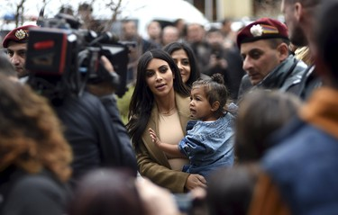 U.S. television personality Kim Kardashian (C) with her daughter North West in hand walks during their visit to Yot Verk Church (The Seven Wounds of the Holy Mother of God), also known as Surb Astvatsatsin Church (Holy Mother of God), in Gyumri April 11, 2015. Kardashian arrived to her ancestors' homeland of Armenia with her rapper husband Kanye West, their child North West and sister Khloe Kardashian on April 8 and were greeted by hundreds of fans.  REUTERS/Hayk Baghdasaryan/Photolure