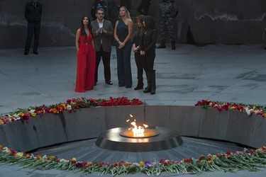 U.S. television personality Kim Kardashian (L) and her sister Khloe Kardashian (C) attend a flower laying ceremony at the Tsitsernakaberd Armenian Genocide Memorial Museum in Yerevan April 10, 2015. Kim Kardashian, visiting her ancestors' homeland of Armenia, placed flowers on Friday at a memorial to the 1915 mass killings of Armenians by Ottoman soldiers.  REUTERS/Vahan Stepanyan/PAN Photo