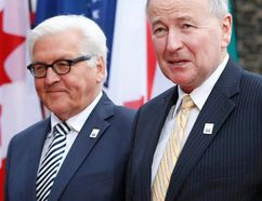 German Foreign Minister Frank-Walter Steinmeier greets his Canadian counterpart Rob Nicholson (R) at Luebeck City Hall, April 14, 2015. G7 foreign ministers will hold a two-day meeting in Luebeck to discuss issues such as Ukraine, the Middle East and Ebola. (REUTERS/Fabrizio Bensch)