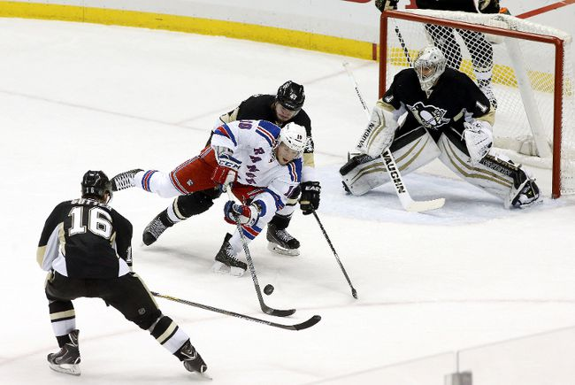 New York Rangers center J.T. Miller (10) attempts a shot as Pittsburgh Penguins center Brandon Sutter (16) and defenseman Simon Despres (middle) and goalie Thomas Greiss (1) defend during the second period at the CONSOL Energy Center. The Rangers won 5-2.  Charles LeClaire-USA TODAY Sports