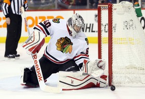 Chicago Blackhawks goalie Corey Crawford makes a save against the Winnipeg Jets at MTS Centre. (Bruce Fedyck/USA TODAY Sports)