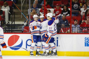 Nail Yakupov, centre, and Ryan Nugent-Hopkins, shown here celebrating a goal with Oilers defenceman Keith Aulie, have both been determined by the team to be unable to play at the world championship due to inury. (USA TODAY SPORTS)